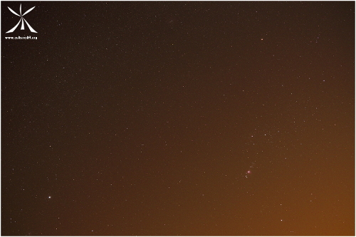 The star of Sirius and the Orion constellation in the twilight glow